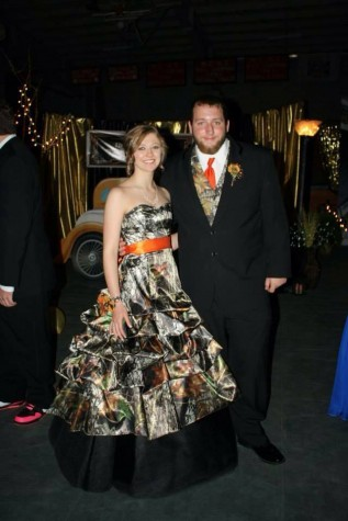 3066 Mossy Oak and Black with orange sash